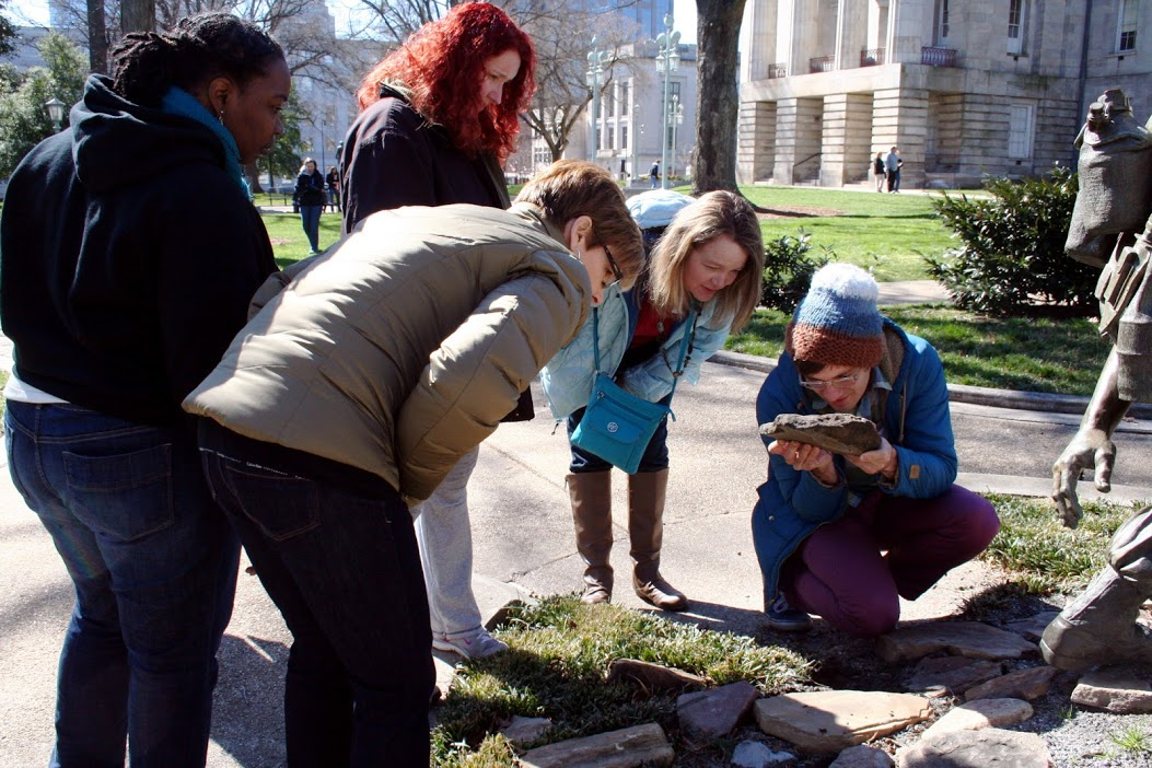 Orange County, North Carolina K-5 school teachers looking at ants on the Capitol grounds.
